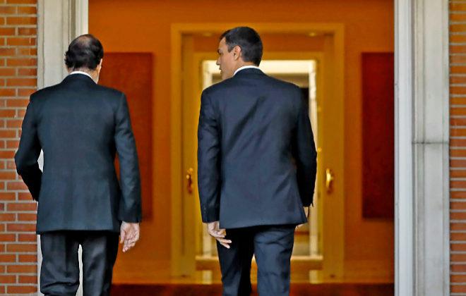 Mariano Rajoy y Pedro Sánchez entran en La Moncloa