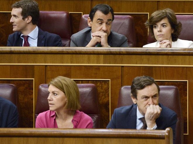 Pablo Casado, Soraya Sáenz de Santamaría y María Dolores de Cospedal, ayer, en el Congreso de los Diputados.