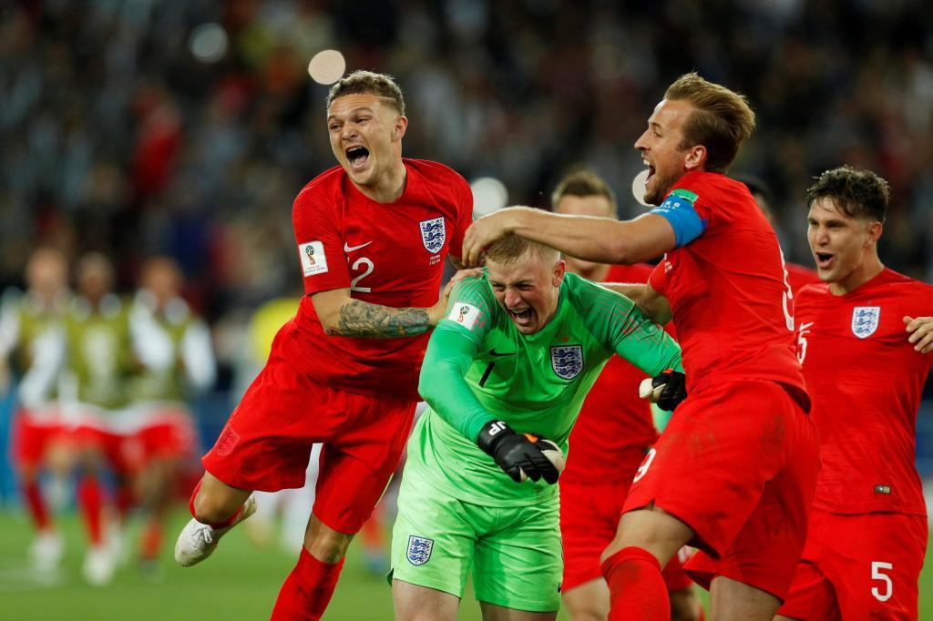 Soccer Football - World Cup - Round of 16 - Colombia vs England - Spartak Stadium, Moscow, Russia - July 3, 2018 England's Jordan Pickford celebrates with team mates after saving Colombia's Carlos Bacca penalty during the shootout REUTERS/John Sibley TPX IMAGES OF THE DAY