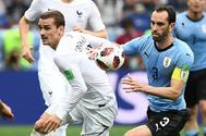 Griezmann y Godín, durante el partidos disputado entre Francia y Uruguay.