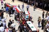 funeral conjunto de varias víctimas de atentados suicidas en la...