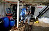 Inmigrantes rescatados por el buque español 'Open Arms', ayer, en la...