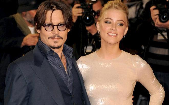 Johnny Depp y Amber Heard en una alfombra roja de 2014