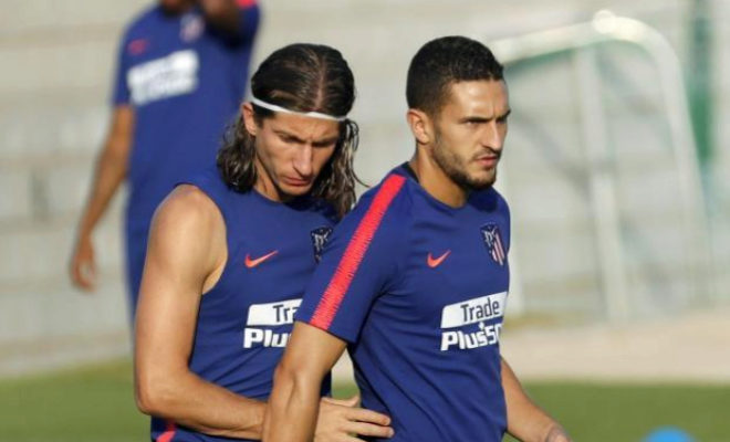 Filipe Luis (izda), junto a Koke, en un entrenamiento del Atlético.