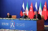 Los presidentes de Rusia, Irán y Turquía, en rueda de prensa, tras su reunión trilateral.