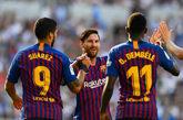 Los jugadores del FC Barcelona, Ousmane Dembele, Lionel Messi y Luis...