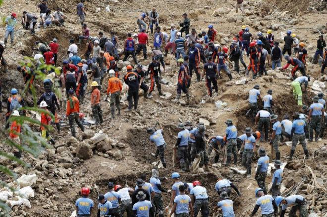 Continúan las labores de búsqueda de víctimas en una mina sepultada por un deslizamiento de tierra causado por el tifón Mangkhut.