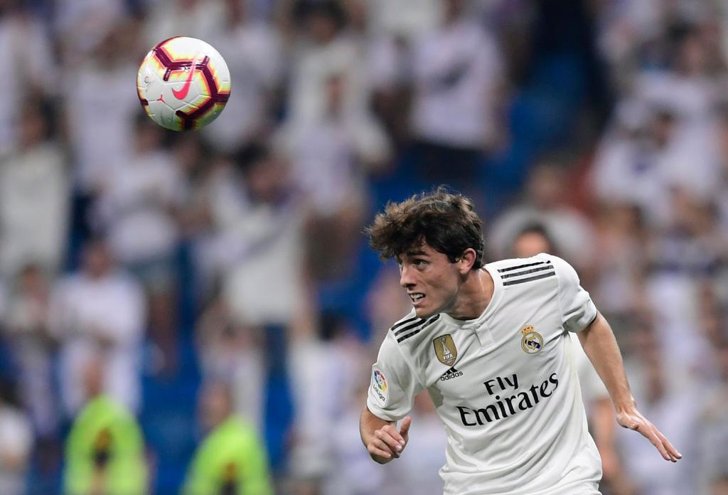 Real Madrid's Spanish defender Alvaro Odriozola eyes the ball during the Spanish league football match between Real Madrid CF and RCD Espanyol at the Santiago Bernabeu stadium in Madrid on September 22, 2018. (Photo by JAVIER SORIANO / AFP)