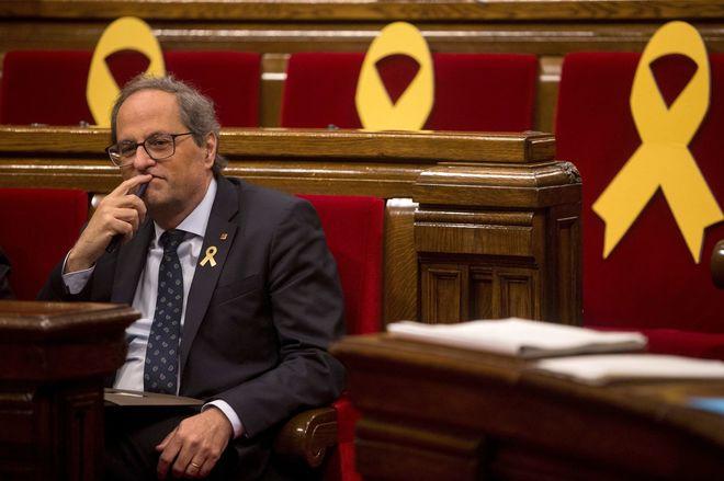 El presidente de la Generalitat, Quim Torra, en el pleno de ayer del...