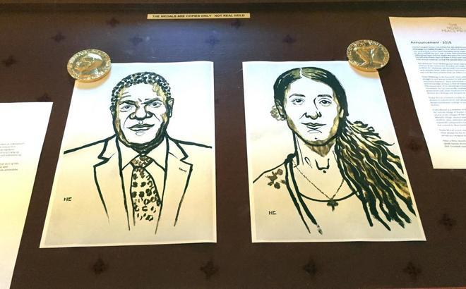 Retratos de los galardonados Denis Mukwege y Nadia Murad expuestos en Oslo.