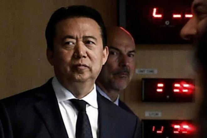 El presidente de Interpol, Meng Hongwei, durante la visita del...