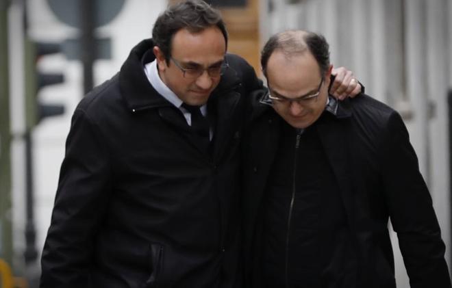 Josep Rull y Jordi Turull, el pasado marzo, se dirigen al Tribunal Supremo antes de su ingreso en prisión.