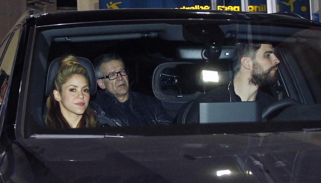 El jugador y su pareja en un coche en una imagen de archivo