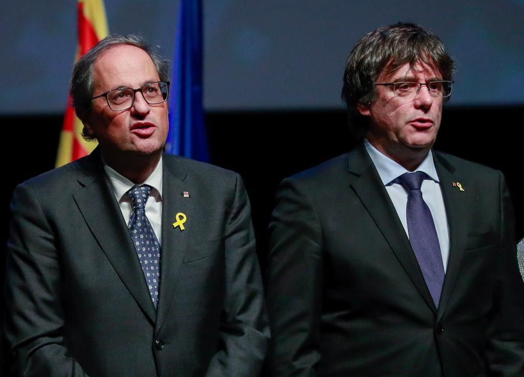 El ex presidente Carles Puigdemont junto al presidente de la Generalitat, Quim Torra, ayer en Bélgica