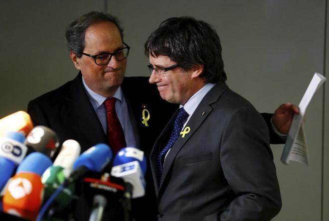 Carles Puigdemont y Quim Torra en una imagen de archivo.