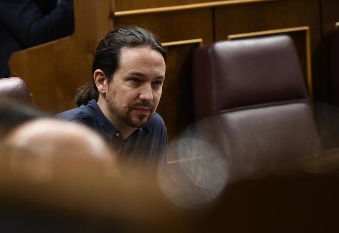 El líder de Podemos, Pablo Iglesias, en una sesión de control en el...