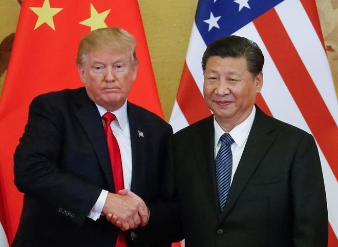 El presidente de EEUU Donald Trump posa con su homólogo de China Xi Jinping en Pekín en 2017.