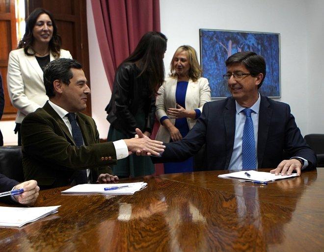 Juan Manuel Moreno y Juan Marín sellan el acuerdo.