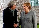 Theresa May y Angela Merkel.