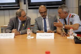 El president, Quim Torra, con el conseller Miquel Buch y el comisario...