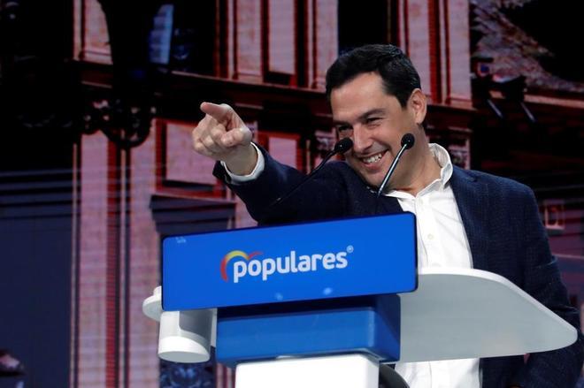 El presidente andaluz, Juanma Moreno, durante su intervención en la...
