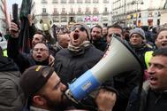 Concentración de taxistas en la Puerta del Sol, en Madrid.