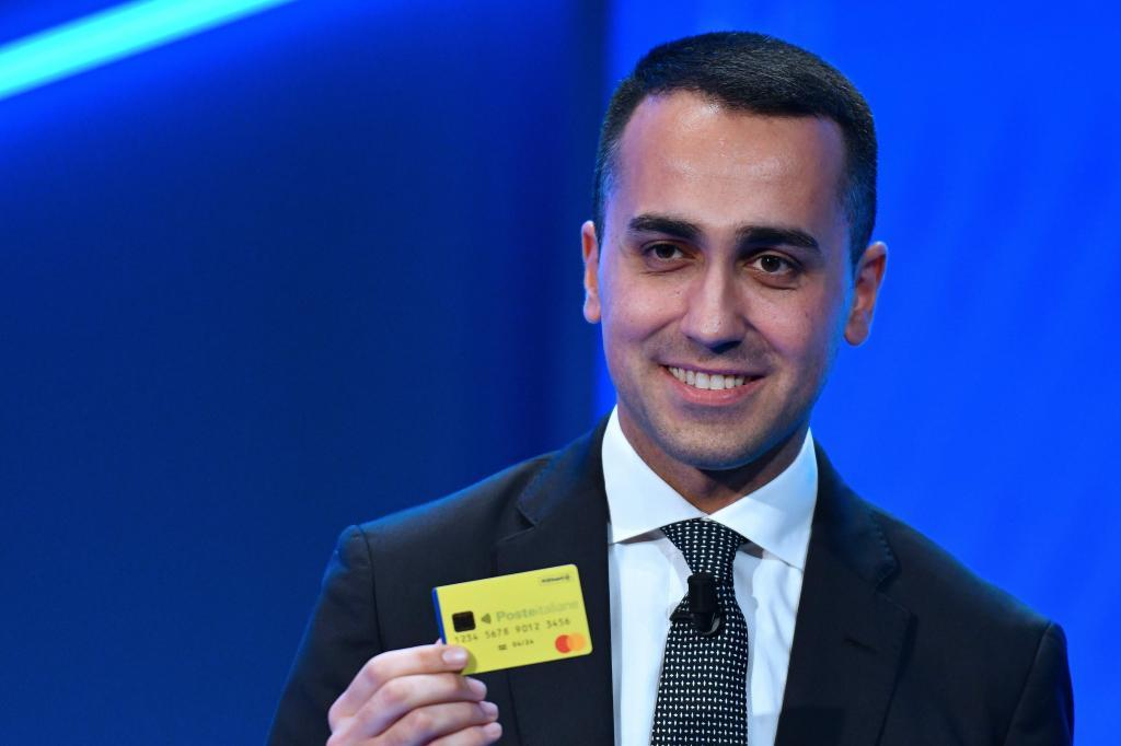"t, Labour and Social Policies Luigi Di Maio, holds the first ""Citizenship Wage"" card during a press preview in Rome on February 4, 2019. - The universal basic income scheme is aimed at the poorest families and job seekers, who will be offered three jobs before losing the right to the ""Citizenship Wage"". (Photo by Alberto PIZZOLI / AFP)"