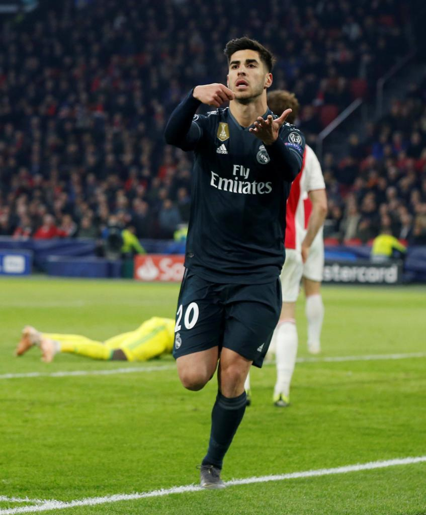Soccer Football - Champions League Round of 16 First Leg - Ajax Amsterdam v Real Madrid - Johan Cruijff Arena, Amsterdam, Netherlands - February 13, 2019 Real Madrid's Marco <HIT>Asensio</HIT> celebrates scoring their second goal REUTERS/Eva Plevier