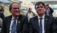 Quim Torra y Carles Puigdemont, el pasado día 18 de febrero, en una conferencia en Bruselas.