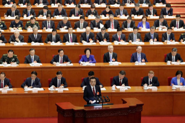 Chinese Premier <HIT>Li</HIT> <HIT>Keqiang</HIT> delivers the work report at the opening session of the National People's Congress (NPC) at the Great Hall of the People in Beijing