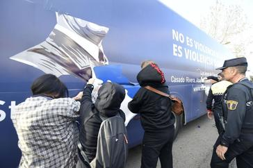 """Protesters try to peeled off part of the vinyl decoration from a bus chartered by the conservative association """"Hazte Oir"""" (Make yourself heard) reading """"It is not gender violence, it is domestic violence"""" in <HIT>Valencia</HIT> on March 5, 2019. - Women's rights have taken centre stage in the election campaigns of Spain's left- and right-wing parties as international women's day nears, even if ultra conservative groups are hitting back this year at what they dub """"radical feminism."""" (Photo by JOSE JORDAN / AFP)"""