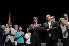 Carles Puigdemont y Oriol Junqueras, durante el acto del TNC en julio de 2017