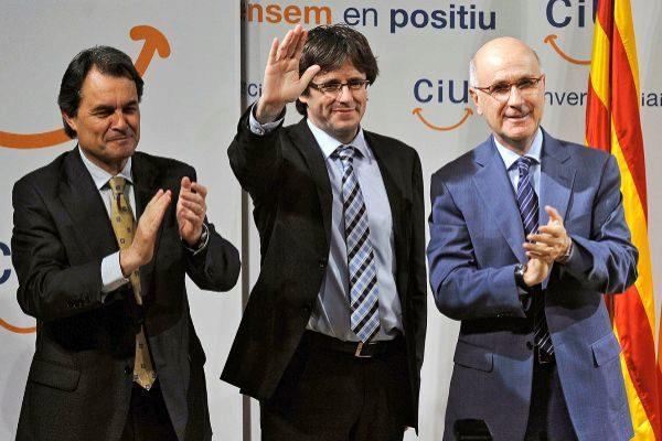 Artur Mas, Carles Puigdemont y Josep Antoni Duran Lleida durante un mitin de la antigua CiU en Gerona.