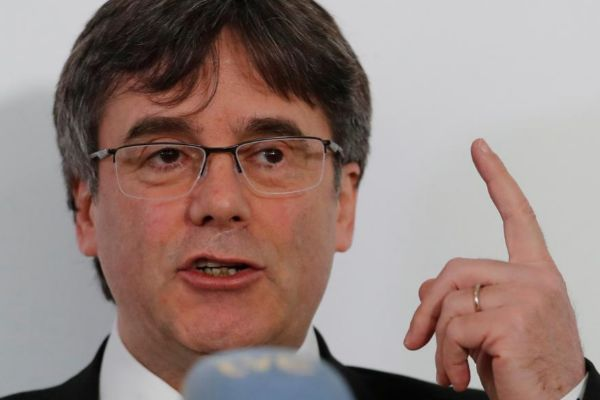 FILE PHOTO: Former Catalan president <HIT>Puigdemont</HIT> reacts as trial over independence bid starts in Madrid