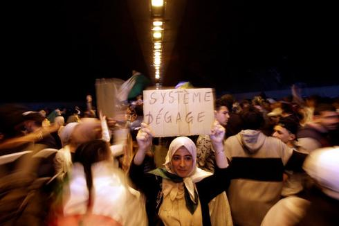 People take part in a protest demanding immediate political change in...
