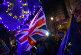 Anti-<HIT>Brexit</HIT> supporters gather outside the Parliament in London