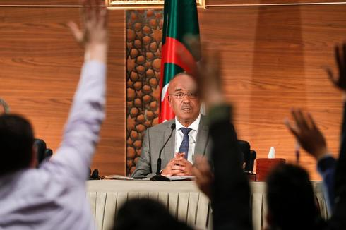 Algeria's newly appointed prime minister, Noureddine Bedoui, holds a...