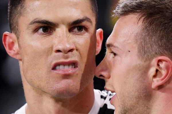 Cristiano celebra con Bernardeschi su tercer gol ante el Atlético.