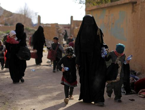 FILE PHOTO: Families of <HIT>Islamic</HIT> state fighters walk as they...