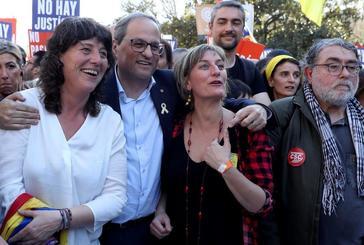 """GRAF5502. MADRID.- El presidente de la Generalitat, Quim <HIT>Torra</HIT> (2i) asiste a la manifestación que bajo los lemas """"Autodeterminación no es delito"""" y """"Democracia es decidir"""" ha sido convocada por más de sesenta colectivos sociales, organizaciones del 15M, entidades republicanas y antifascistas, además de ANC y ñmniun Cultural, este sábado en Madrid."""