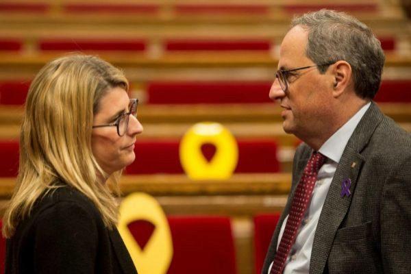 El presidente de la Generalitat, <HIT>Quim</HIT> <HIT>Torra</HIT>, conversa con la consellera de Presidencia, Elsa Artadi, tras la sesión de control al Govern en el pleno del Parlament, en pleno clima preelectoral ante los comicios electorales del 28 de abril.