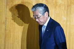 Japan's Olympic Committee President (JOC) Tsunekazu <HIT>Takeda</HIT> arrives at a JOC board meeting in Tokyo on March 19, 2019. (Photo by CHARLY TRIBALLEAU / AFP)