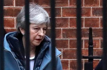 Britain's Prime Minister <HIT>Theresa</HIT> <HIT>May</HIT> leaves from the rear of 10 Downing Street in London on March 20, 2019. - Prime Minister <HIT>Theresa</HIT> <HIT>May</HIT> asked the EU to delay Brexit until June 30 as she scrambled to contain a deepening political crisis, but faced warnings that Britain could still crash out of the bloc in nine days. (Photo by Tolga AKMEN / AFP)
