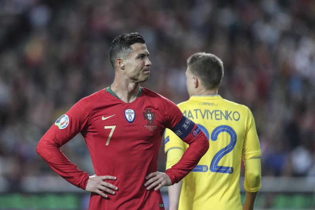 Lisbon (Portugal).- Portugal's <HIT>Cristiano</HIT> <HIT>Ronaldo</HIT> reacts during the UEFA EURO 2020 qualification match between Portugal and Ukraine at Luz Stadium in Lisbon, Portugal, 22 March 2019. (Ucrania, Lisboa) EPA/