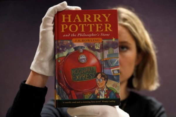 "One of the first ever copies of ""<HIT>Harry</HIT> Potter and the Philosopher's Stone"" by J.K. Rowling, is held by a staff member at Bonhams auctioneers, ahead the Fine Books, Manuscripts, Atlases and Historical Photographs sale in London"