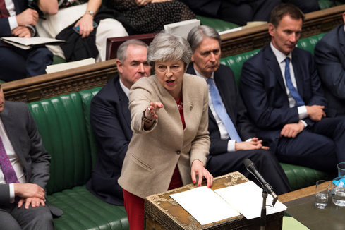 British Prime Minister <HIT>Theresa</HIT> <HIT>May</HIT> speaks at the House of Commons in London
