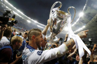 Soccer Football - Champions League Final - Real <HIT>Madrid</HIT> v Liverpool - NSC Olympic Stadium, <HIT>Kiev</HIT>, Ukraine - May 26, 2018 Real <HIT>Madrid</HIT>'s Sergio Ramos celebrates winning the Champions League with the trophy REUTERS/Kai Pfaffenbach - RC150B703120