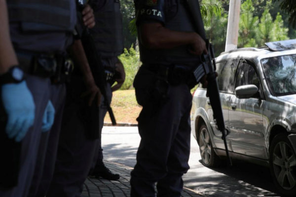 Policemen patrol a road, where they faced a gang after attempting an armed bank robbery in <HIT>Guararema</HIT>