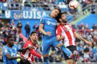 GRAF7401. <HIT>GETAFE</HIT> (MADRID).- El centrocampista del <HIT>Getafe</HIT> Francisco Portillo (2d) pelea un balón con el centrocampista del Athletic de Bilbao Raúl García (d) en el partido de la trigésima primera jornada de LaLiga que se disputa hoy en el Coliseo Alfonso Pérez .