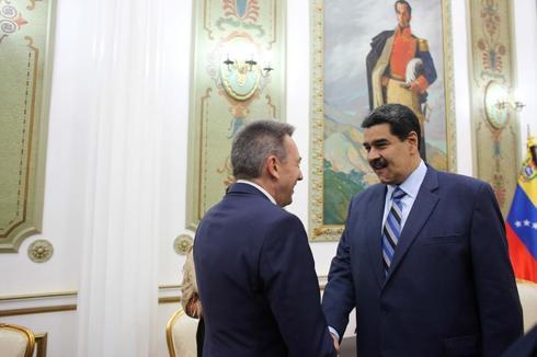 Venezuela&apos;s President Nicolas Maduro and <HIT>Peter</HIT>...